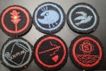 OLD CLOTH PATCHES WHICH I THINK MAY BE GIRL GUIDES. Click for more information...