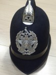 old British English Police Bobbys helmet in great condition. Click for more information...